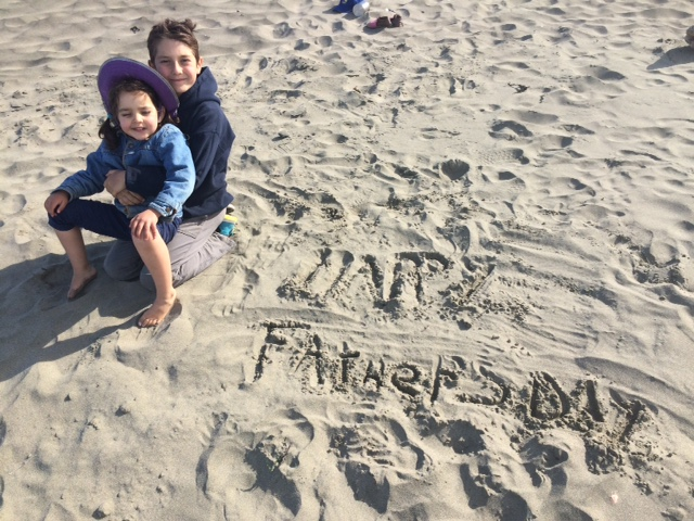 Marcus and Ilaria saying Happy Father's Day in the sand.