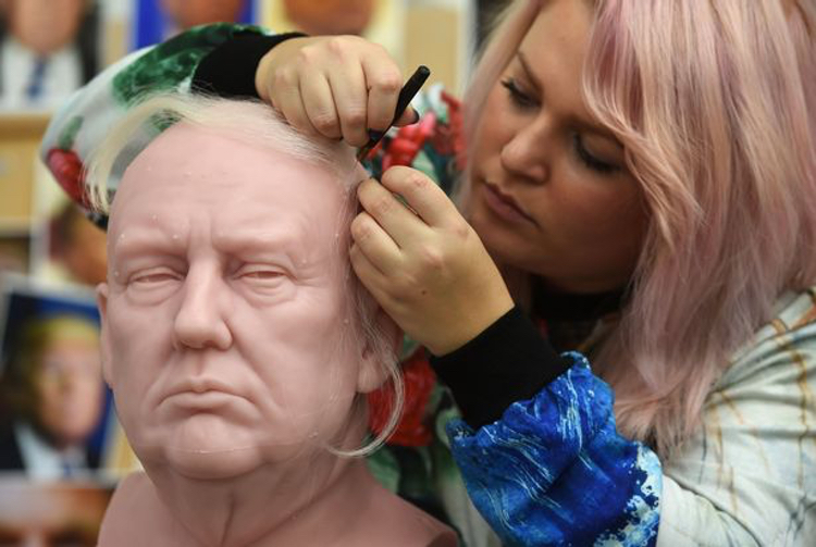 Madame Tussaud's Sophie Crudgington inserts Yak hairs onto the unfinished wax figure of Donald Trump.